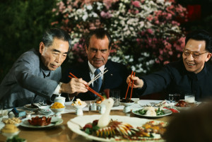 February 27,1972, Shanghai, China --- President Nixon holds his chopsticks in the ready position as Premier Chou En-lai (left) and Shanghai Communist Party leader Chang Chun-chiao reach in front of him for some tidbits at the beginning of the farewell banquet here. --- Image by © Bettmann/CORBIS